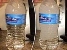 'supercooled' bottles of water instantly turn rock hard when banged on a table