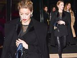 Amber Heard looks chic in leather trousers and smart jacket in Paris