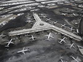flights heading for newark airport have been grounded after 2 drones were spotted flying nearby