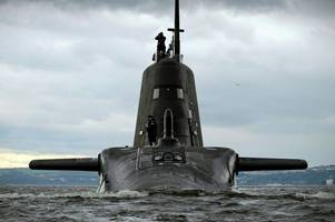 Nuclear-powered Royal Navy submarine in near miss with ferry