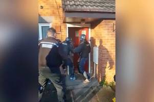 moment police storm sleepy chasetown cul-de-sac and bash down front door