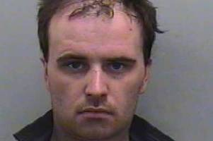 Man described as 'zombie' jailed after brutal hammer attack on love rival