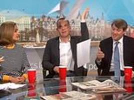 Exasperated money saving expert Martin Lewis hurls his papers in the air