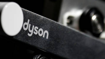 theresa may says dyson is committed 'long-term' to the uk