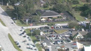 at least five people dead after shooting at florida bank