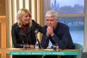 phillip schofield groans he'll be 'sick in helmet' on this morning after national television awards