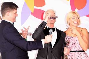 this morning's holly willoughby and phillip schofield arrive on motorbikes after nta win