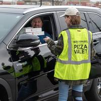 noble roman's craft pizza & pub completes roll-out of pizza valet curbside carry-out service