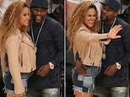 floyd mayweather stands courtside with mystery date as he watches la lakers