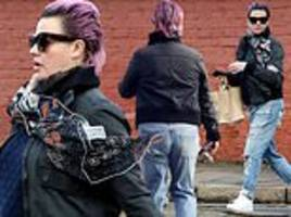lisa armstrong appears stony-faced as she shows off her new purple hairdo in london