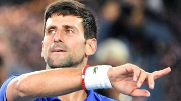 djokovic motivated by federer's record of 20 grand slam titles