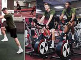 arsenal duo welbeck and holding work out in the gym as they continue recovery from injuries