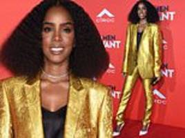 kelly rowland dazzles in gold and black pantsuit at what men want premiere