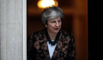 may seeks to renegotiate brexit agreement with the eu
