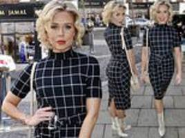love island's gabby allen cuts a ladylike figure in a checkered dress