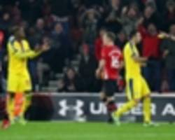 zaha apologises after applause leads to red card