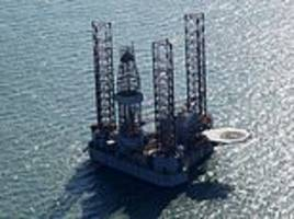 oil rig begins drilling between two of britain's most famous coastal landmarks