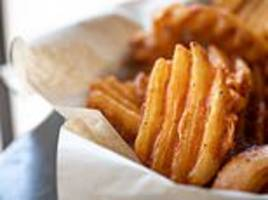 restaurant is forced to remove its $15 schindler's list-themed waffle fries nachos