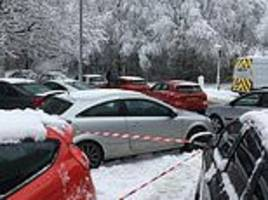 outraged driver sees traffic warden 'slapping tickets on vehicles that were abandoned in snow'