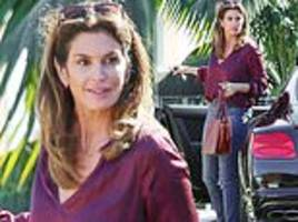 cindy crawford looks understatedly stylish in a burgundy blouse and jeans as she steps out for lunch