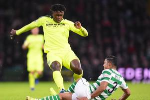 darnell johnson praises celtic star emilio izaguirre and insists he never intended to hurt him