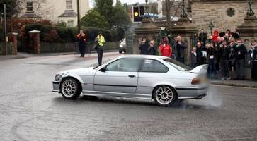mourners shocked as cars perform doughnuts outside funeral of crash victim
