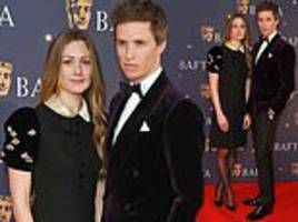 eddie redmayne and wife hannah bagshawe as they lead the stars attending the bafta film gala