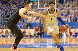 lawson's 25-point surge leads jayhawks over cowboys, 84-72
