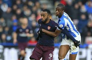 arsenal beats huddersfield 2-1 in english premier league