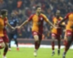 younes belhanda, mbaye diagne's efforts guide galatasaray past trabzonspor