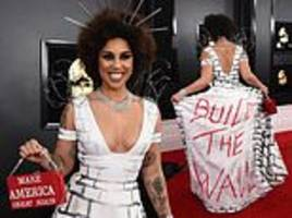 outspoken donald trump supporter and singer joy villa wears a 'build the wall' dress