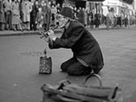 Photos of Charlie Chaplin impersonator in London in 1951 entertaining crowds