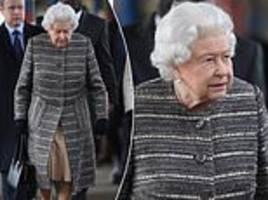queen boards a train as she heads back to london from sandringham