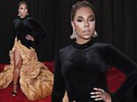 grammys red carpet: ashanti puts her best foot forward in a puffy dress
