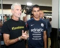 Hakeem al-Araibi arrives home in Australia to a crowd of support