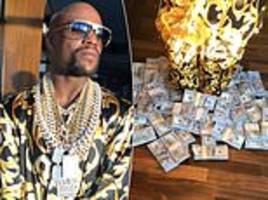 floyd mayweather shows off lavish lifestyle with piles of cash at his feet