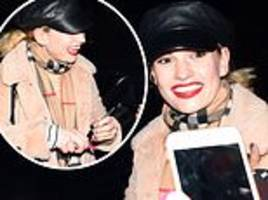 Lily James sports a broad smile as she meets fans after All About Eve rehearsals