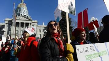 denver teachers reach pay agreement with school district to end strike
