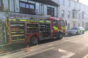 one person led to safety as smoke from town centre fire spreads to neighbouring properties
