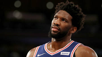 watch: joel embiid crashes into msg crowd, hurdles over actress regina king