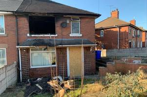 'flames were coming out the window' - residents' shock as police hunt arsonists after fire at vandal-hit house undergoing renovation