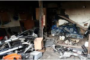 Police discover vehicle parts from 14 stolen cars worth £500,000 in 'chop shop' raid