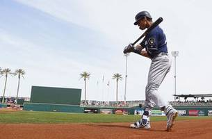 brewers' yelich back to work after short offseason