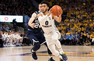 marquette slides down to no. 11, wisconsin falls to no. 22 in ap top 25 poll