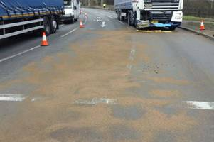 live: long delays on a38 and m1 after crash causes large oil spill at roundabout