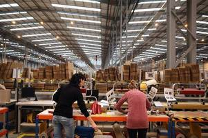 torbay council is going ahead with a £15m deal to buy a new amazon warehouse near exeter despite concerns