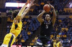 k-state defeats west virginia 65-51 to stay atop big 12