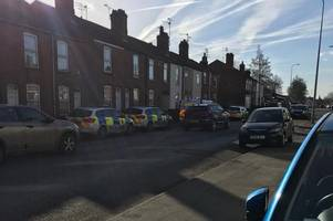 four police vehicles rush to house on busy road in lincoln