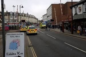 woman dies after police called to incident in paignton town centre