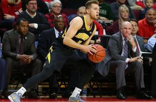 jordan bohannon scores 17 points in second half and overtime to lift n0.21 iowa past indiana